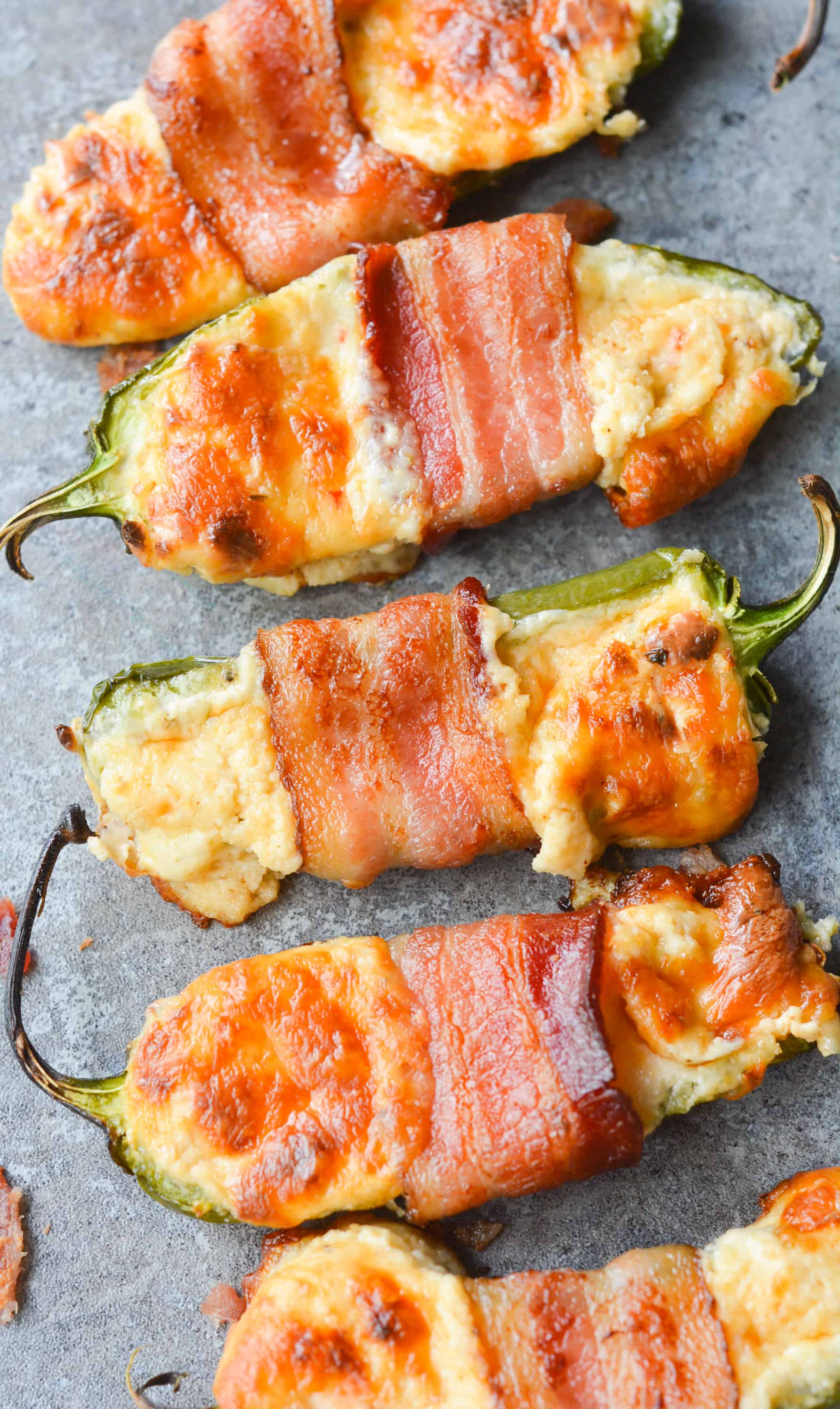 These Bacon Wrapped BBQ Jalapeno Poppers are an incredibly savory, flavorful low carb dish. Perfect to bring to any backyard BBQ, or to just enjoy at home! | heyketomama.com