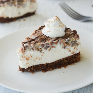 This Keto Pecan Pie Cheesecake is PERFECT for the Holiday Season. It's so delectable your non-low carb loved ones will never know the keto difference! | heyketomama.com