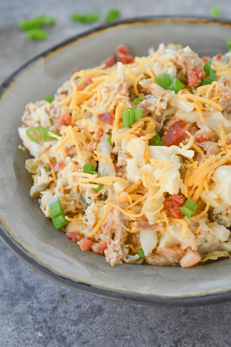 This loaded keto cauliflower bowl is a rich and flavorful, filling meal that will remind you of a baked potato!