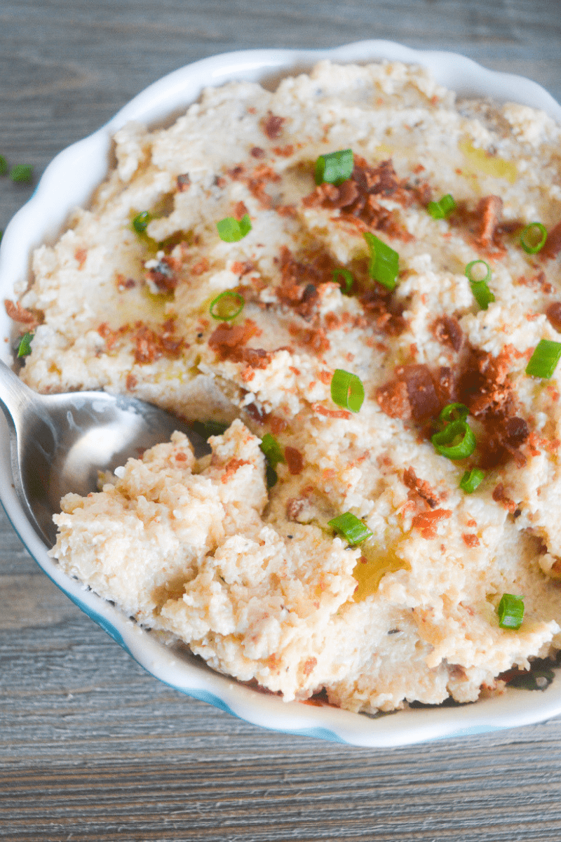 This Keto Mashed Cauliflower is the perfect low carb side dish for a hearty meal. Whether that's a savory companion for your Thanksgiving Dinner, or a flavorful side for your baked Chicken Thighs! | heyketomama.com