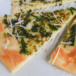 keto spinach pesto flatbread slices on a white background