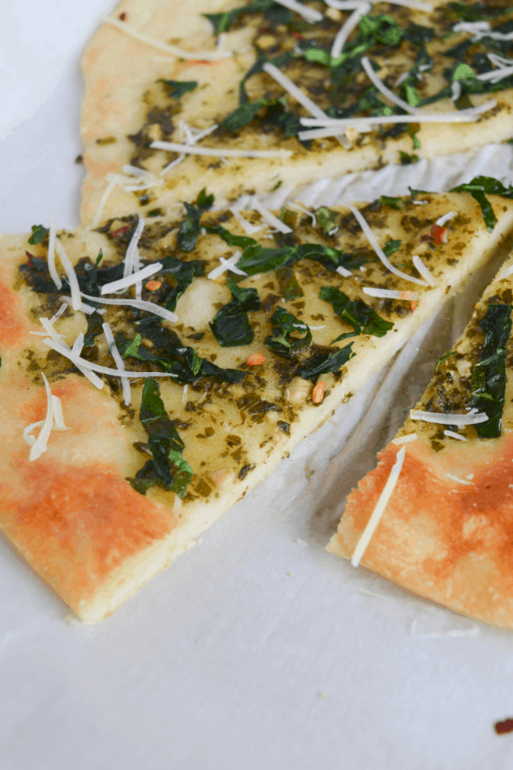 keto spinach pesto flatbread slices on a white background
