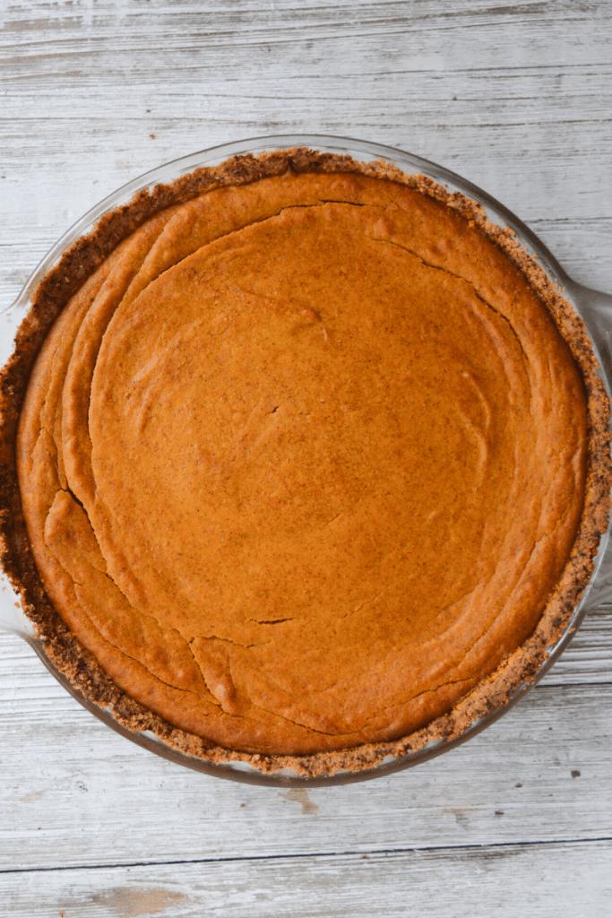 full keto pumpkin pie in glass pie dish