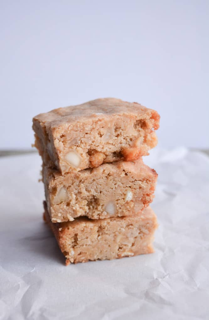 stack of three keto blondies on a piece of parchment paper