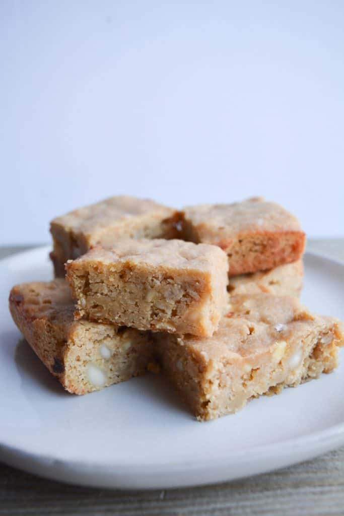 stack of several blondies on a white plate