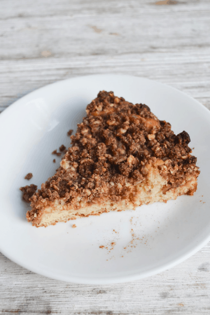slice of keto coffee cake sitting on a white plate