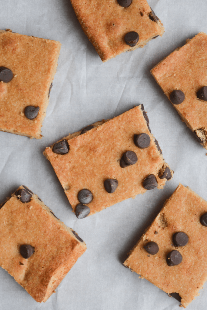 keto cookie bars spaced out on a piece of parchment paper
