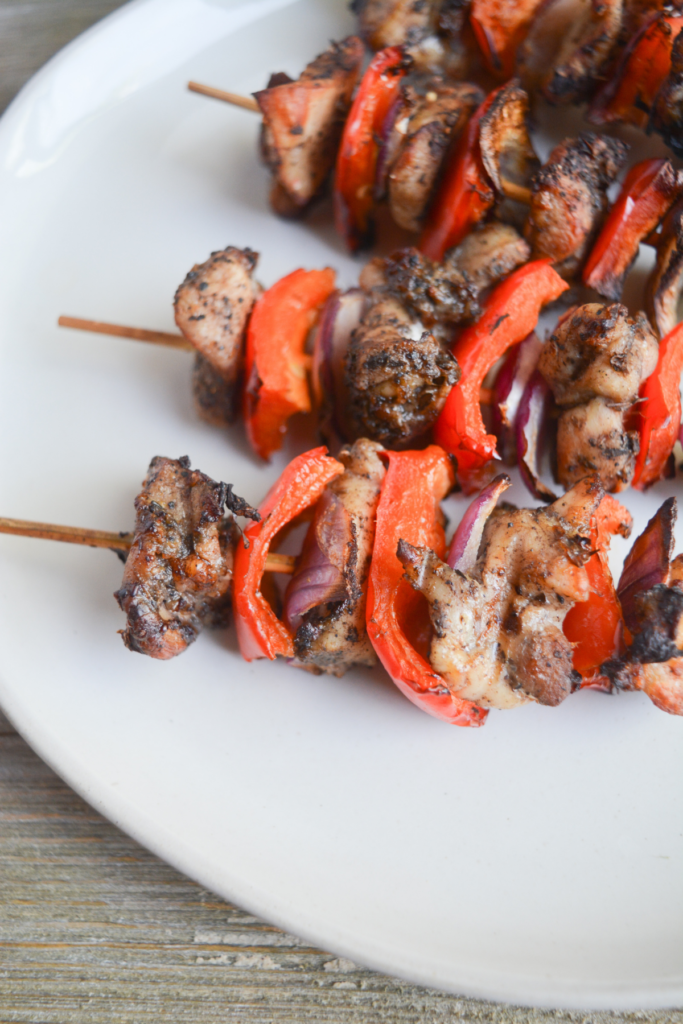 air fryer chicken kebabs sitting on a white plate