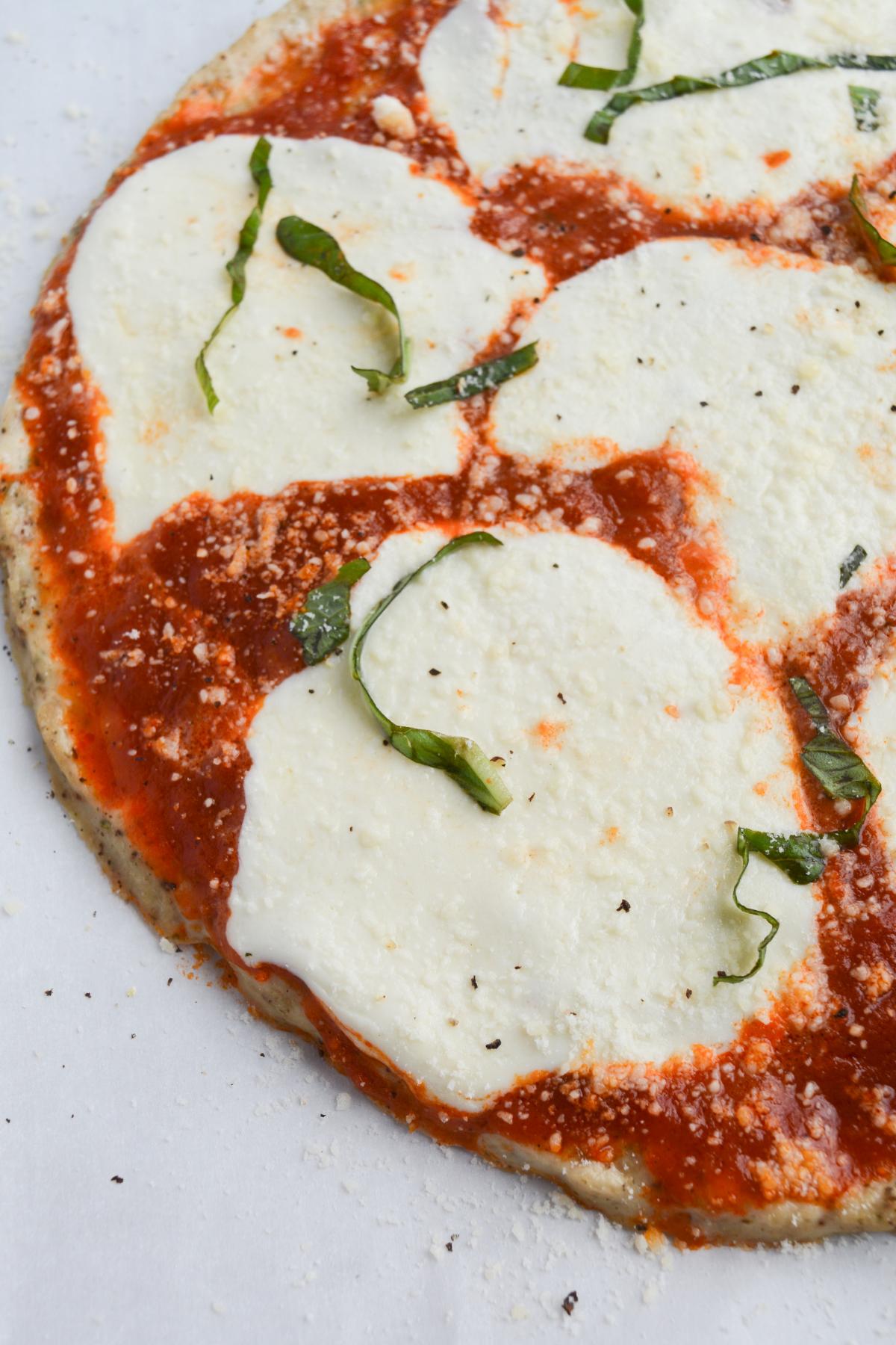 closeup of half of chicken parm pizza