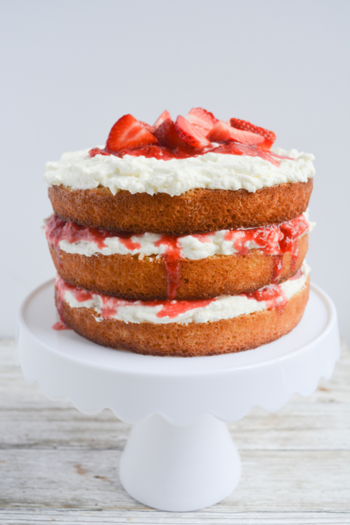 keto strawberry shortcake layer cake with whipped frosting and strawberry jam