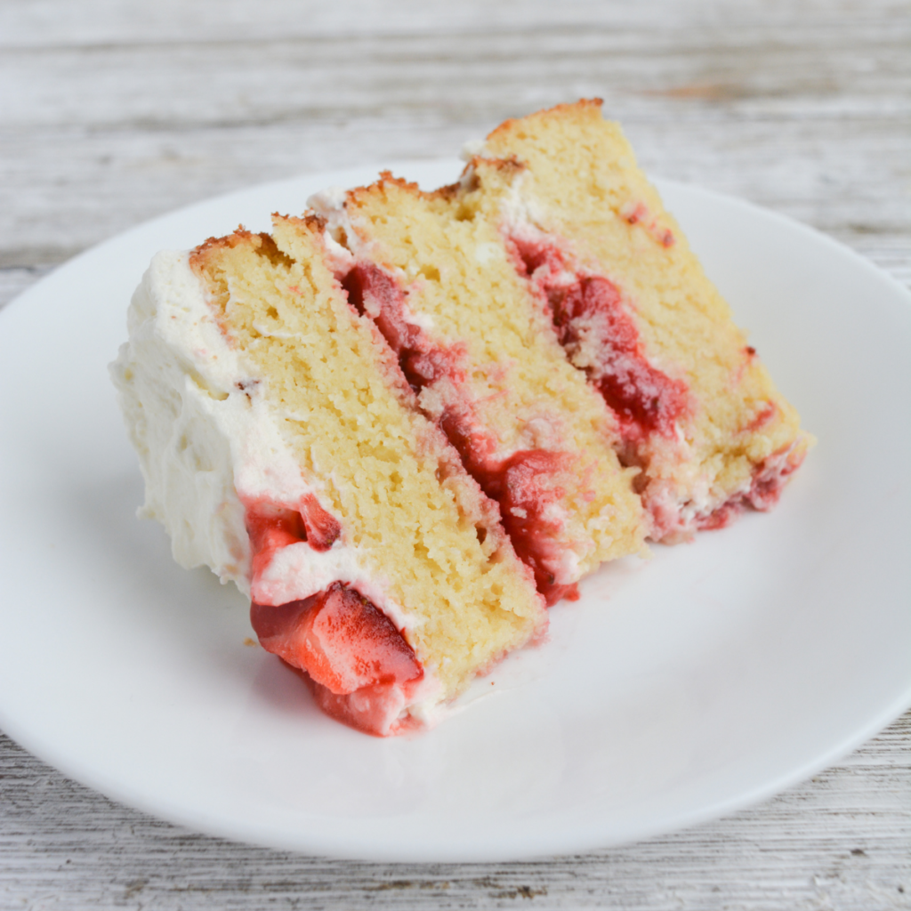 slice of strawberry shortcake cake on a white plate