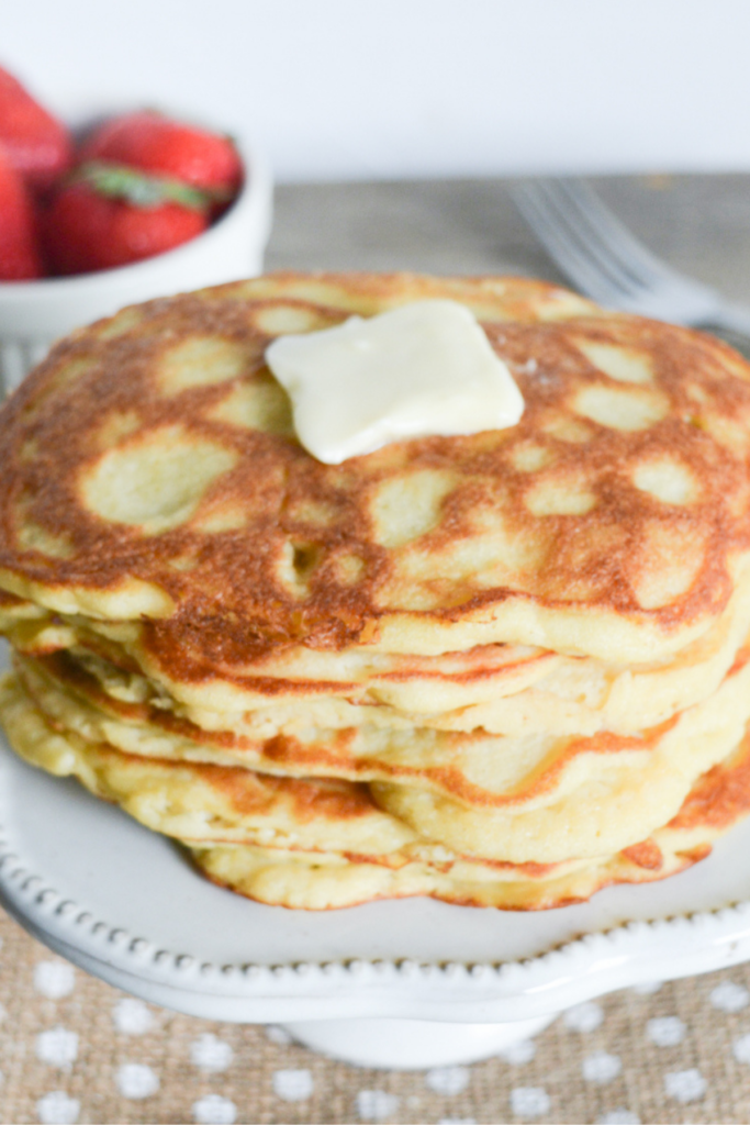 stack of keto pancakes, topped with a pat of butter