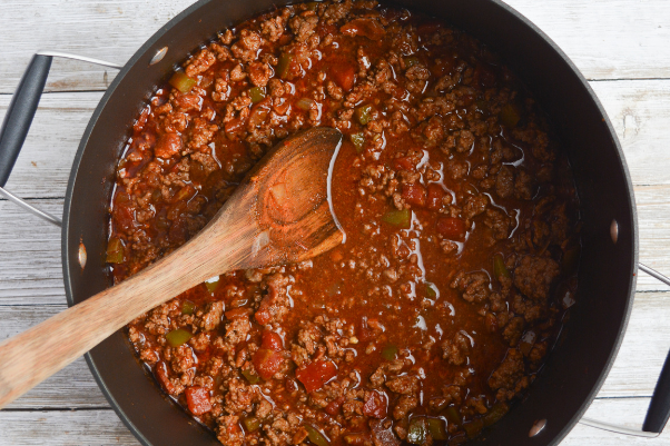 step five for cooking low carb chili: adding everything together and simmering