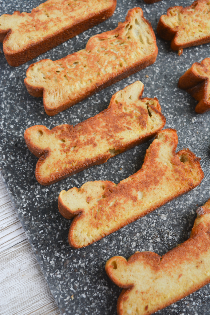 several slices of french toast sticks on a cutting board