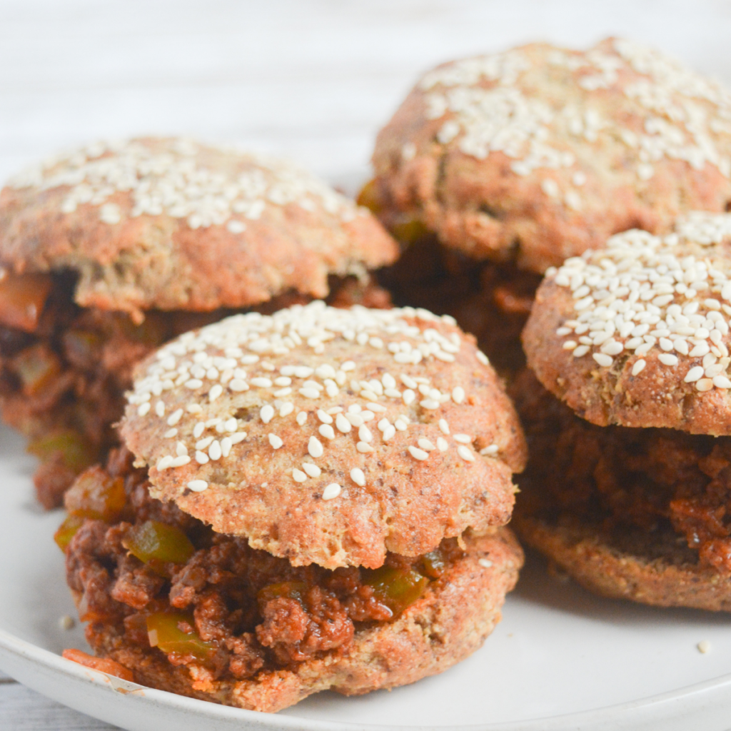 close up on four keto sloppy joes sandwiches with a low carb hamburger bun on each