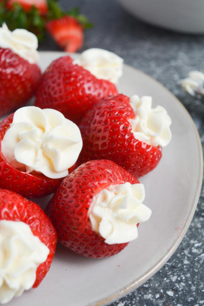 cheesecake stuffed strawberries on a white plate